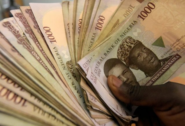 Economists say worries about the fragile currency have stopped Nigeria's central bank from cutting rates