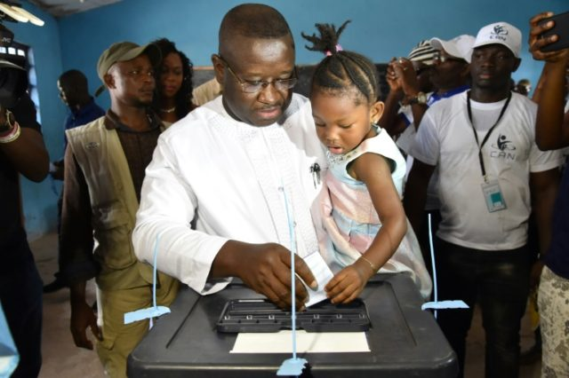 Sierra Leone's people party presidential candidate former general Julius Maada Bio casts his ballot at the polling station in Freetown on March 31, 2018 during Sierra Leone presidential run-off