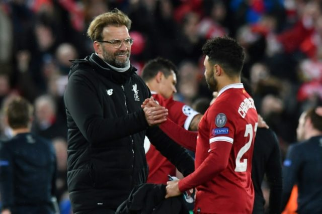Shake on it: Liverpool manager Jurgen Klopp with goal scorer Alex Oxlade-Chamberlain