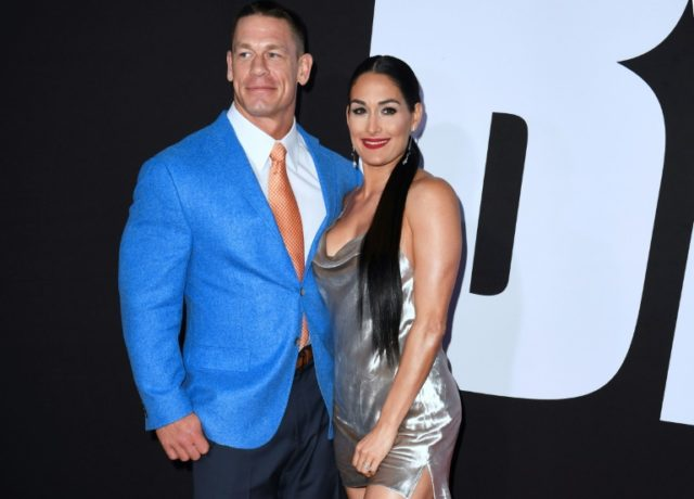 Actor and wrestler John Cena - here with his wrestler friend Nikki Bella -- is one of three parents who stumble upon their daughters' pact to lose their virginity on prom night in 'Blockers'
