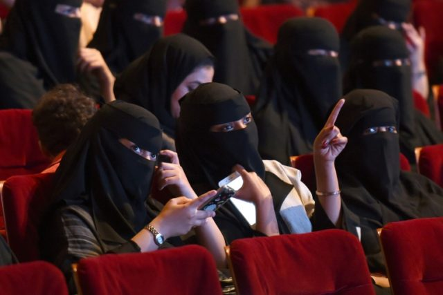 Saudi women enjoy a rare trip to the movies on October 20, 2017 at a cultural centre in Riyadh