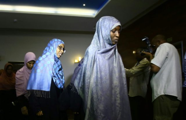 The women were presented to the media on their return to Sudan
