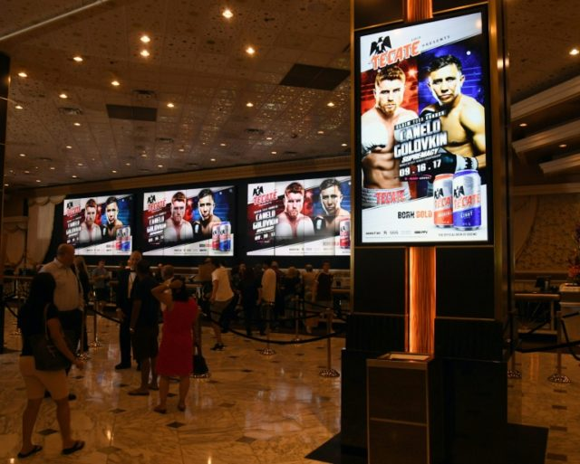 Screens in the MGM Grand Hotel & Casino lobby advertise the now cancelled fight between WBC, WBA and IBF middleweight champion Gennady Golovkin and Canelo Alvarez in Las Vegas, Nevada