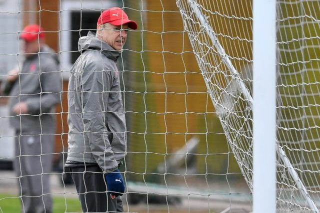 Net gains: Arsenal's French manager Arsene Wenger attends a training session on Wednesday