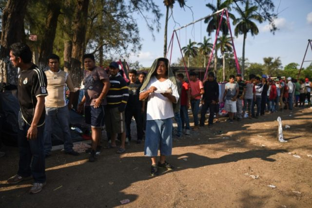 Central Americans crossing Mexico in a migrant caravan that has infuriated the US president queue for breakfast in Matias Romero