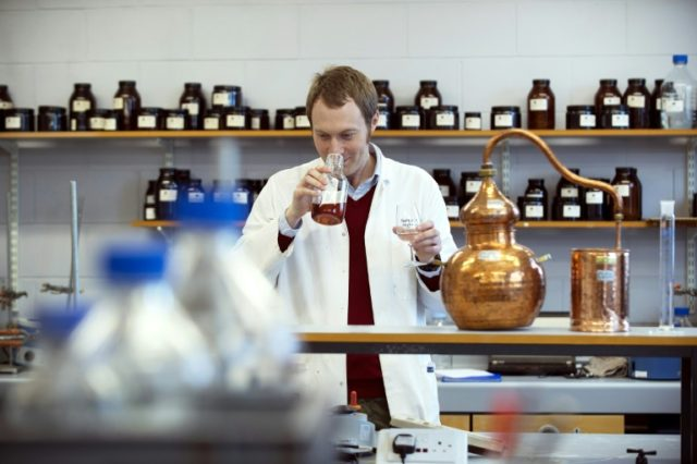 Assistant professor Matthew Pauley's shelves arepacked with herbs, spices and flavourings used in experiments with gin -- but they are kept well away from the whisky stills