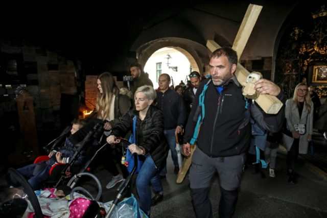 Sasa Pavlic walked 200 kilometres carrying a heavy wooden cross on his back to protest Croatia's purchase of military jets