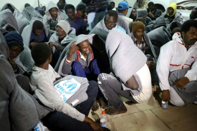 Illegal migrants at a naval base in Tripoli on March 31, 2018, after they were rescued off Libya's coast