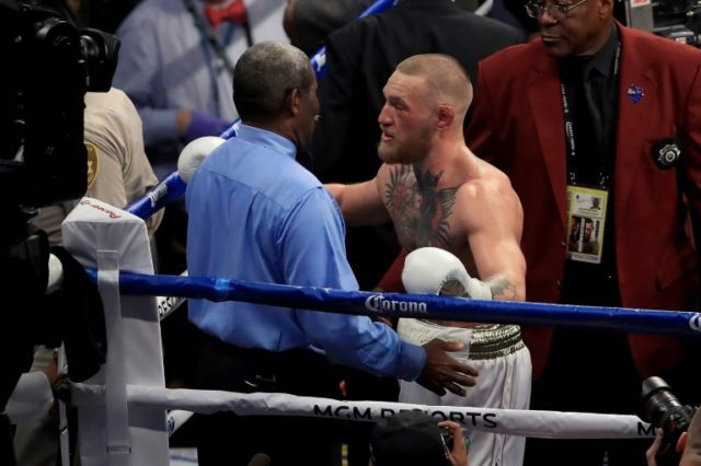 Conor McGregor, seen here speaking to referee Robert Byrd after losing to Floyd Mayweather in their super welterweight boxing match in August, 2017, at T-Mobile Arena in Las Vegas, Nevada, attacked a shuttle bus carrying fighters in New York