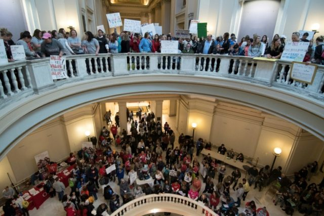 Oklahoma teachers, seen rallying at the state capitol on April 4, are part of a growing movement of US educators protesting low pay and cuts to public schools
