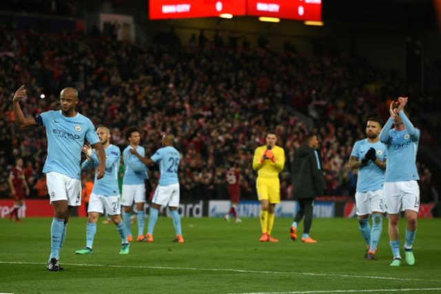 Manchester City players react at the final whistle during the UEFA Champions League match against Liverpool on April 4, 2018