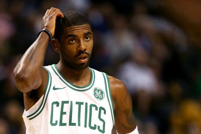 Kyrie Irving of the Boston Celtics looks on during the first half against the Charlotte Hornets at TD Garden on October 2, 2017 in Boston, Massachusetts