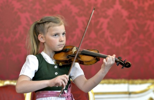 Seven year old Anna Caecilia Pfoess will play a violin used by Mozart on a state visit to China