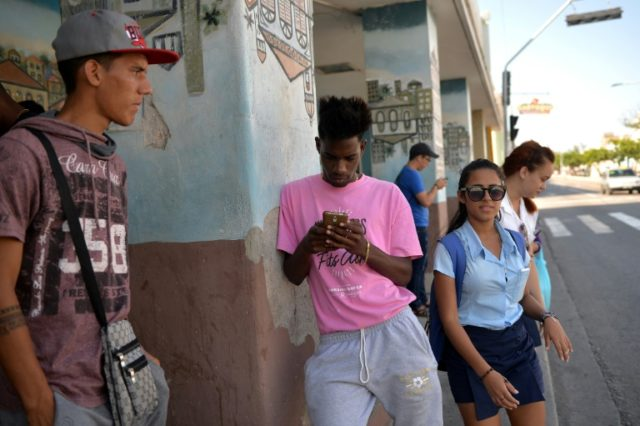 Young Cubans, like those seen here recently on a Havana street, have mixed feelings about the island's future once Raul Castro steps down, but say they are ready to play their part