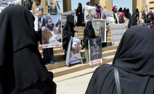 Relatives of Lebanese nationals accused of links to extremist groups gather during a protest outside the Mohammad al-Amin mosque in downtown Beirut on April 6, 2018, to demand a general amnesty for their family members