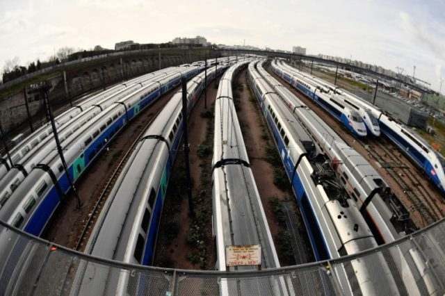 TGV high speed trains stand stationery on tracks outside the Gare de Lyon train station in Paris, on the second day of three months of rolling rail strikes by the staff of French public railways service SNCF.