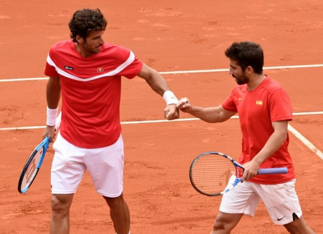 Battling: Spain's Feliciano Lopez and Marc Lopez