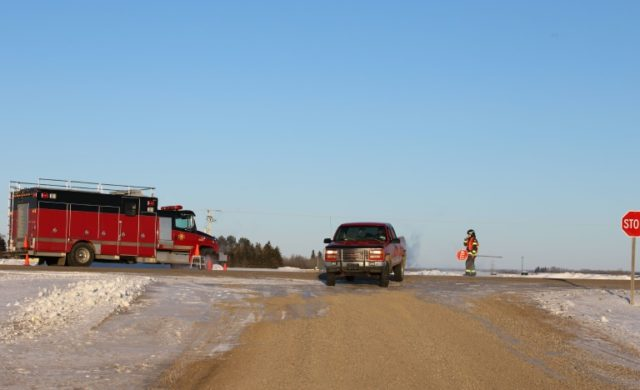 An emergency vehicle is seen near the crash site after a bus carrying a junior ice hockey team collided with a semi-trailer truck in rural Saskatchewan province, killing 14 people