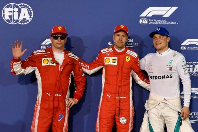 Championship leader Sebastian Vettel grabbed pole ahead of his Ferrari teammate Kimi Raikkonen and Valtteri Bottas of Mercedes for Sunday's Bahrain Grand Prix