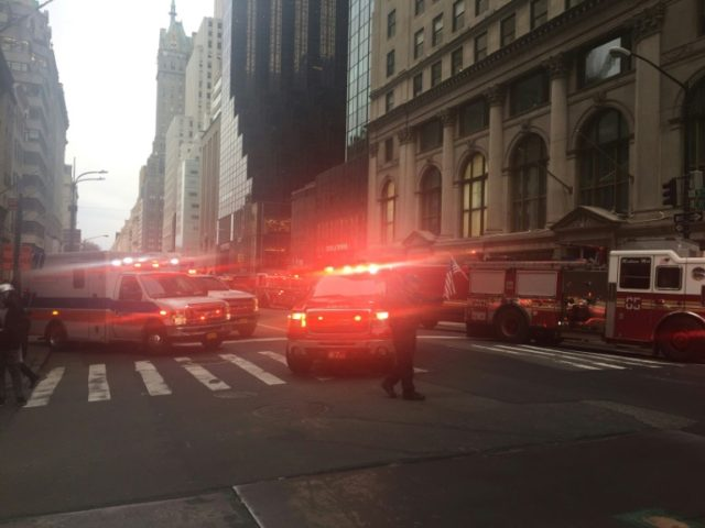 Fire trucks arrive outside Trump Tower on 5th Avenue in New York during a fire on the 50th floor of the building owned by US President Donald Trump