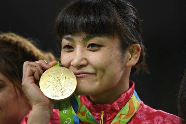 Japan's Kaori Icho celebrates on the podium after winning the gold medal in the women's 58kg freestyle wrestling event at the Rio Olympics in 2016