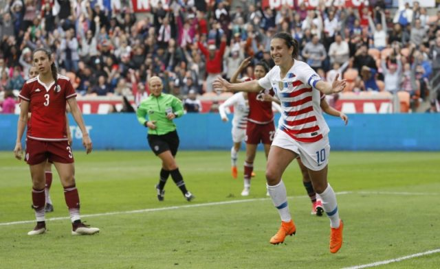 Carli Lloyd of United States celebrates after scoring against Mexico