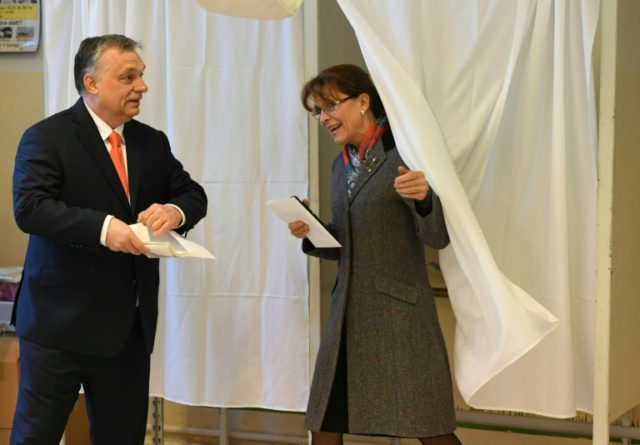 Hungarian Prime Minister Viktor Orban (L) and his wife Aniko Levai(R) vote at a polling station located ina school in Budapest.
