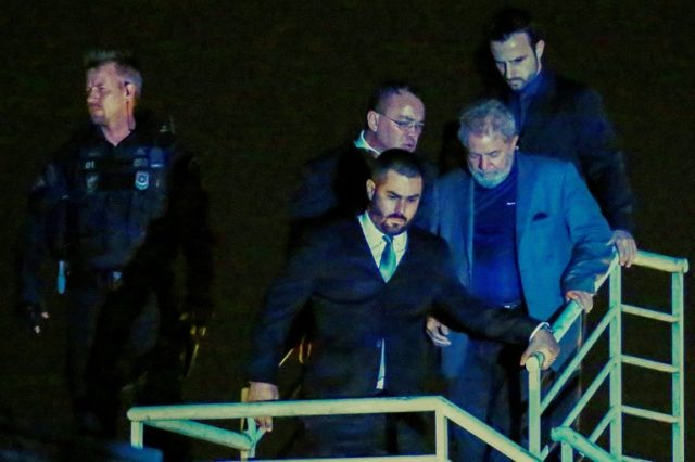 Brazil's former president Lula arrived at police headquarters in the southern city of Curitiba late on Saturday, where he will serve out his 12-year sentence