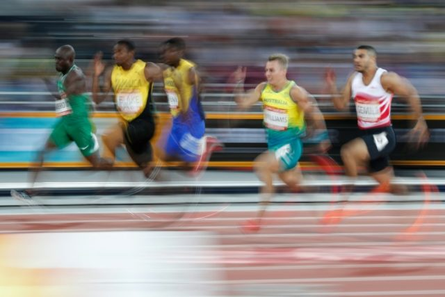 Jamaica's Yohan Blake (2nd L) qualified fastest for the men's 100m final at the Commonwealth Games.