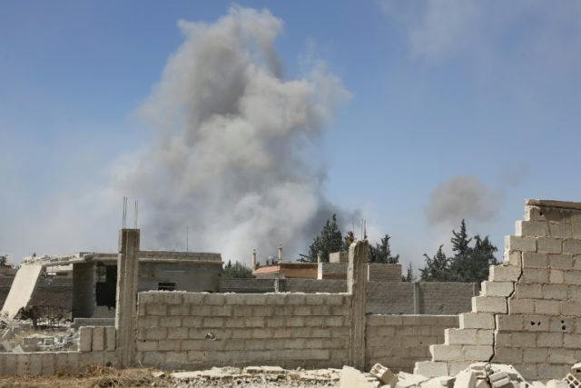 Smoke billows in the town of Douma, the last opposition holdout in Syria's Eastern Ghouta, on April 7, 2018, after Syrian regime troops resumed a military blitz to pressure rebels to withdraw