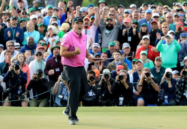 Patrick Reed of the United States celebrates after making par on the 18th green to win the 2018 Masters Tournament
