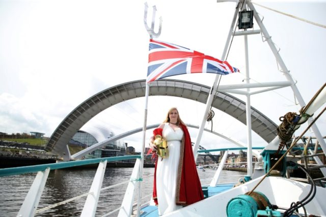 A woman dressed as Britannia, poses as a flotilla of fishing vessels passes under Newcastle's Millennium Bridge, kicking off a protest against a deal that would see Britain continue to adhere, for now, to the Common Fisheries Policy