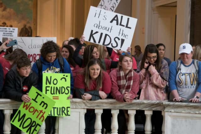 Kids join the teachers' rally at the state capitol in Oklahoma City, April 4, 2018