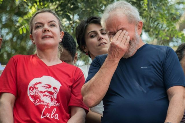 Brazil's Workers' Party president Gleisi Hoffmann led a crowd of supporters in surrounding Luiz Inacio Lula da Silva ahead of his expected arrest at the weekend