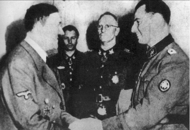 A photo dated 1944 of Leon Degrelle (R) being greeted by Adolph Hilter after the battle of Cherkassy