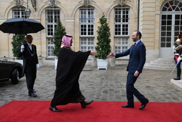 French Prime Minister Edouard Philippe, right, greets Saudi Crown Prince Mohammed bin Salman upon his arrival for talks at the Hotel de Matignon in Paris on Monday