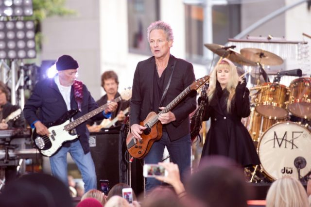 Fleetwood Mac says it has cut ties once again with guitarist Lindsey Buckingham, center