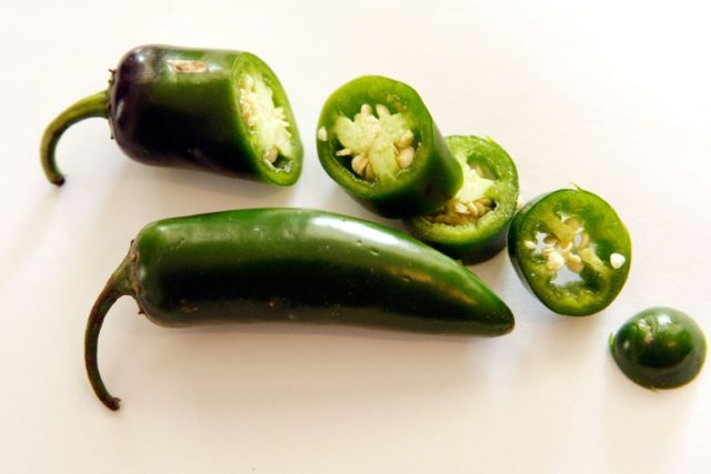 Jalapeno chilli peppers, which rate 2,500 to 8,000 Scoville Heat Units (SHU). The world's hottest pepper, the Carolina Reaper, scores an average of 1,641,183