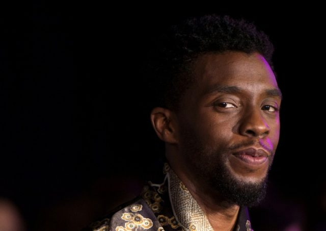 """""""Black Panther"""" features an almost entirely black cast led by Chadwick Boseman, seen here at the movie's world premiere in January"""