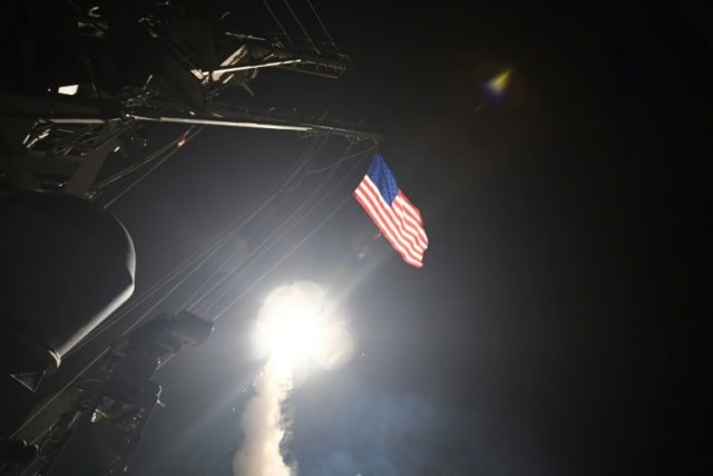 A cruise missile blasts off from the USS Porter during last year's strike on a Syrian air base in retaliation for a chemical attack