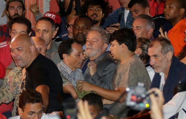 Brazilian former President Luiz Inacio Lula da Silva (C) leaves the Metallurgical Union on his way to Sao Paulo airport on Saturday to begin serving a 12-year sentence for corruption