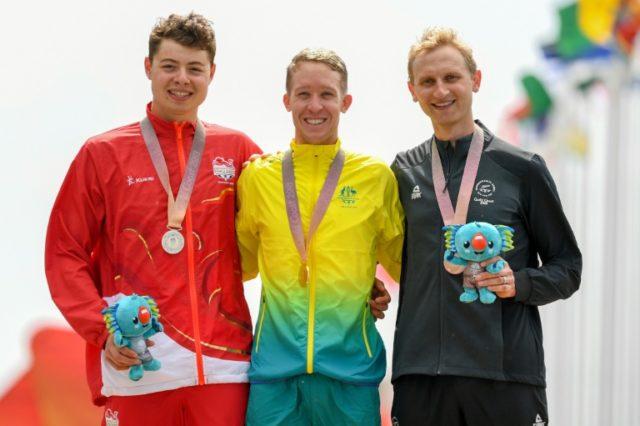 Gold medallist Cameron Meyer (centre), Harry Tanfield (left) and New Zealand's bronze medallist Hamish Bond (bronze)