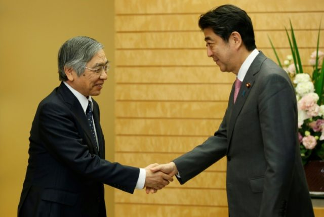 Kuroda (L) meets Japan's Prime Minister Shinzo Abe at Abe's official residence