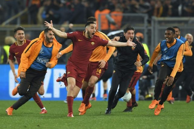 AS Roma players celebrate the team's third goal, scored by Greek defender Kostas Manolas, which ultimately led to a 3-0 upset win over Barcelona on Tuesday night
