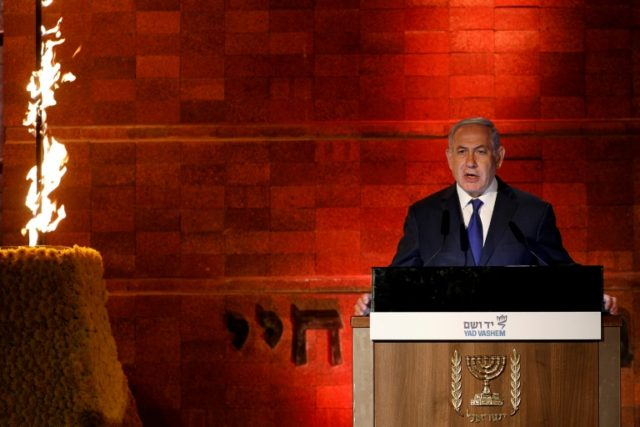 Israeli Prime Minister Benjamin Netanyahu delivers a speech during the state ceremony to mark Holocaust Martyrs and Heroes Remembrance Day on April 11, 2018