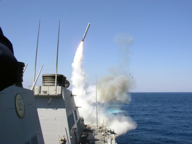 The guided missile destroyer USS Porter launches a Tomahawk missile toward Iraq during the initial stages of US-led invasion in 2003