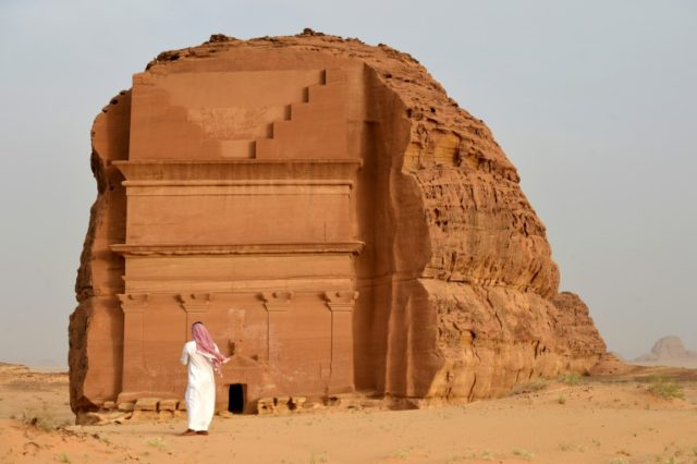 A man stands outside the Qasr al-Farid (Lonely Castle) tomb at the Madain Saleh UNESCO World Heritage site in Saudi Arabia on April 1, 2018