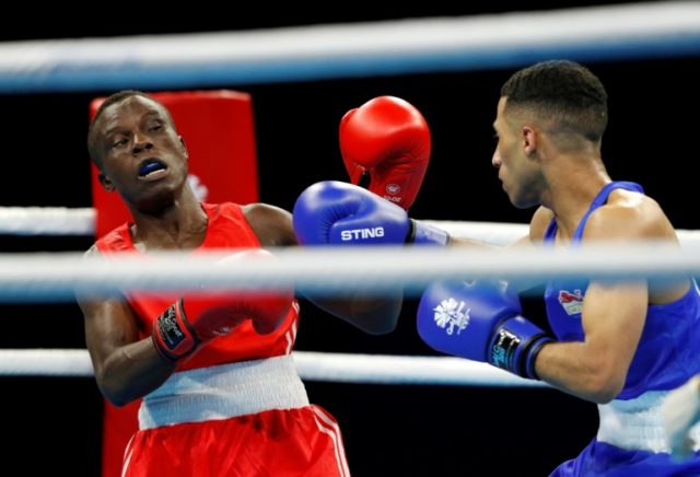 Boxer Simplice Fotsala (red) was among five athletes from conflict-hit Cameroon who have gone missing from the Commonwealth Games in Australia