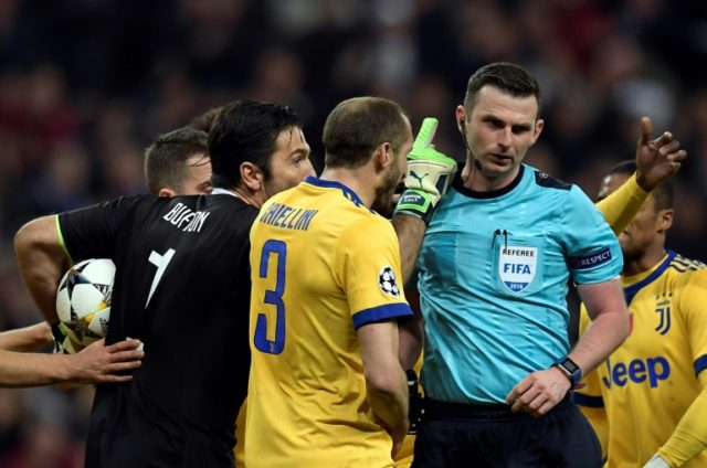 Anger management: Juventus goalkeeper Gianluigi Buffon argues with the referee after the injury time penalty decision