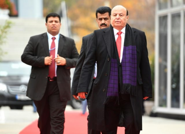 Yemeni President Abedrabbo Mansour Hadi (R) arrives to attend a session of the UN conference on climate change in Bonn, Germany on November 15, 2017
